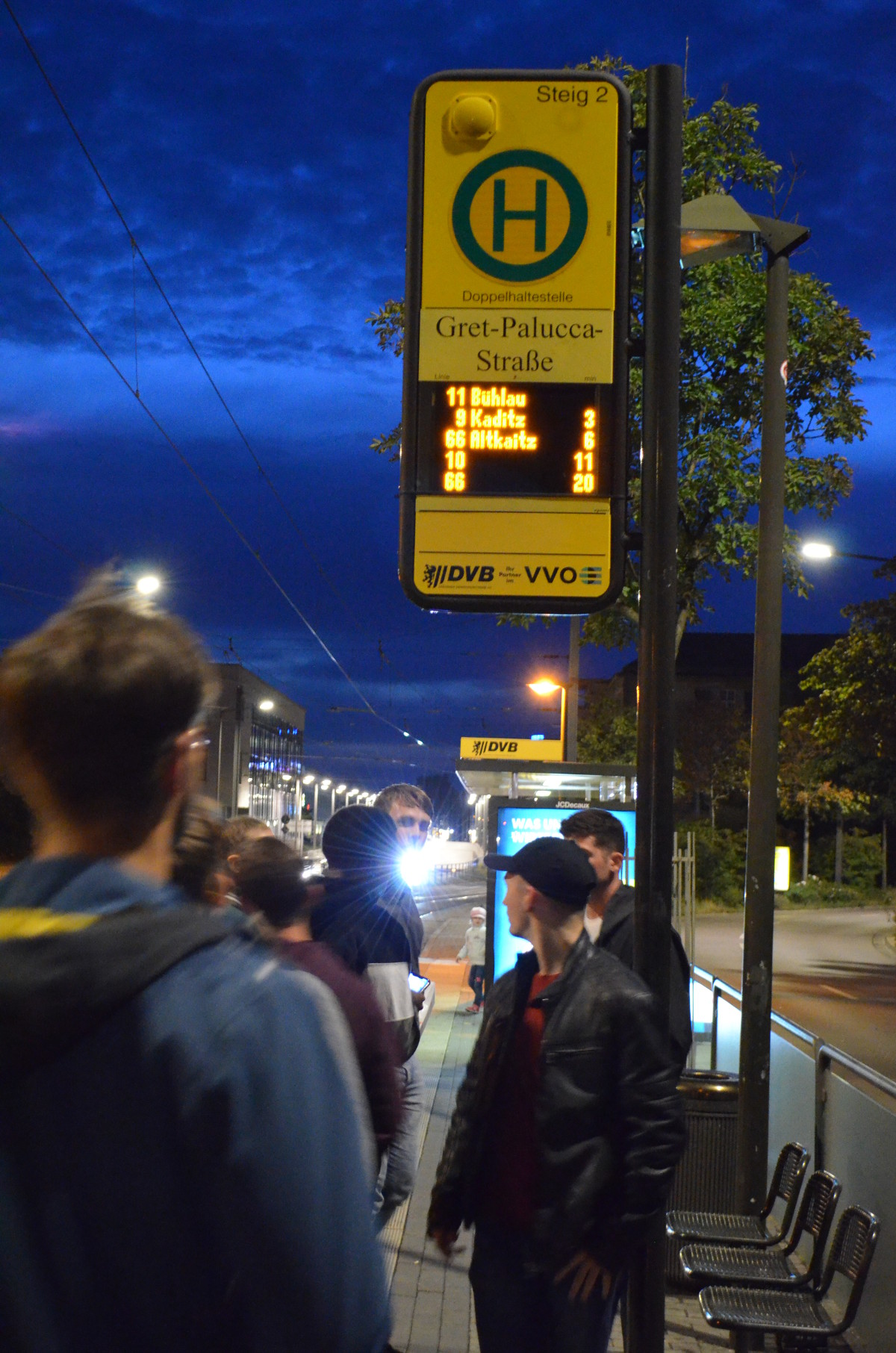 A few of the students at an tram stop